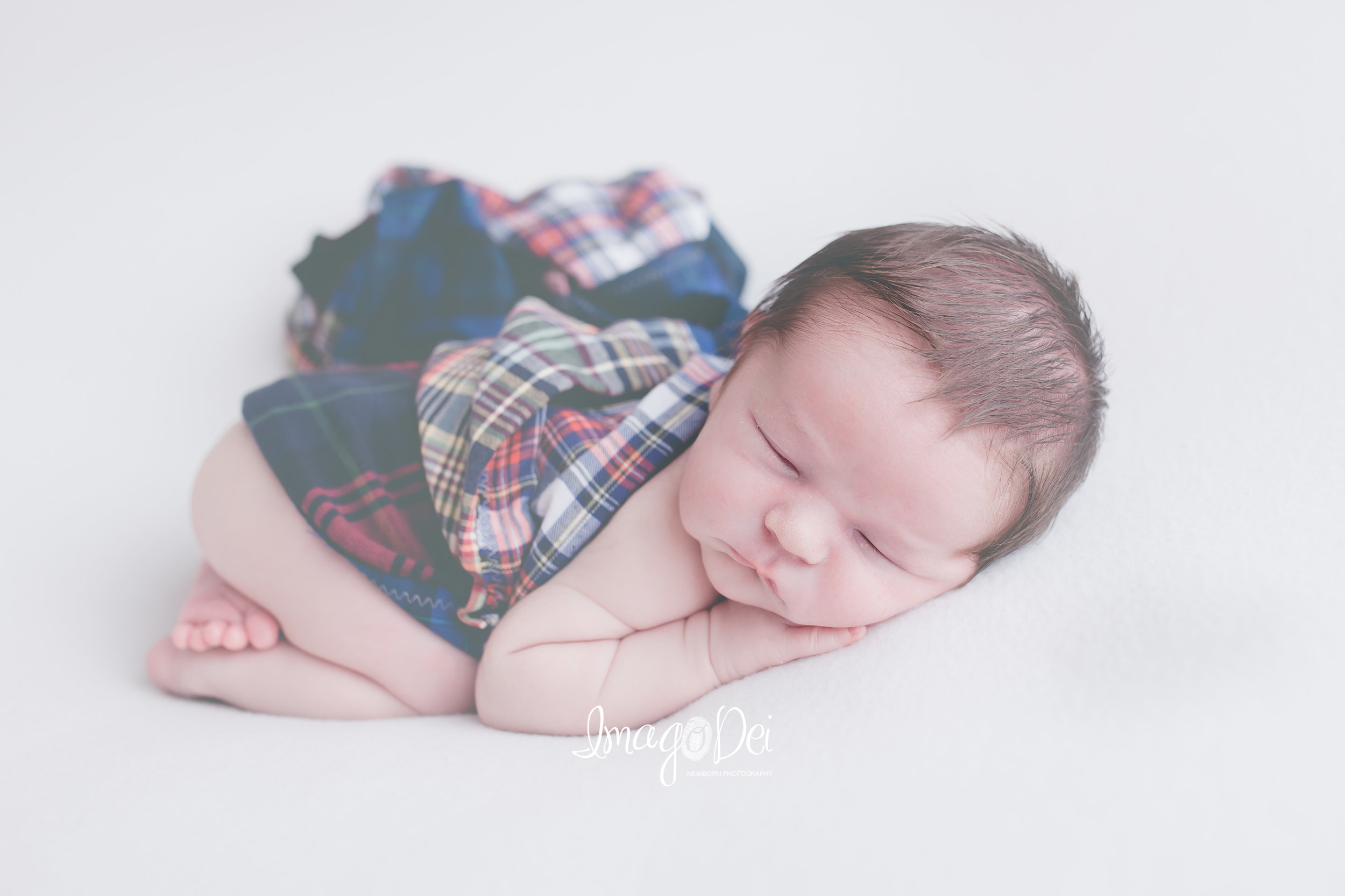 "- ""We LOVED working with Imago Dei! Crystal made us so comfortable and captured the sweetest pictures of our newest addition. The finished images were amazing and she has a quick turn-around time.""-Kristin J"