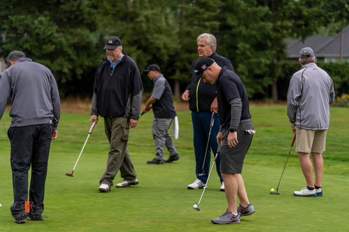 Trio Group plays in the golf scramble.