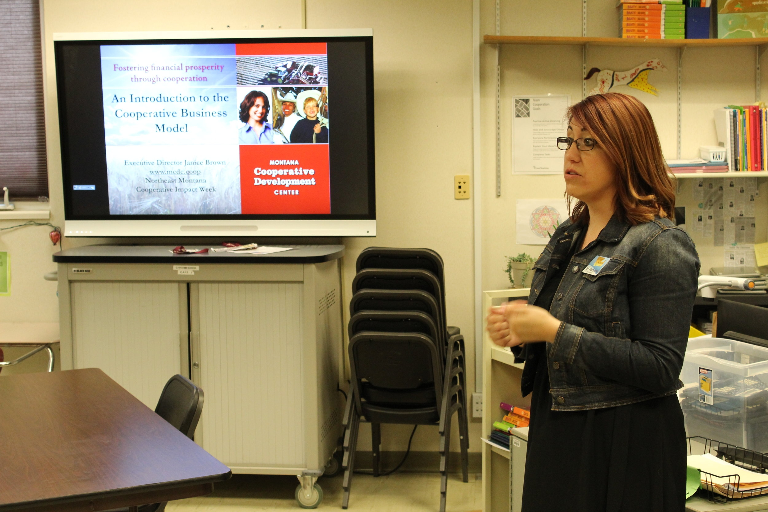 Cooperative Development Specialist Tori Matejovsky presenting to students at Wolf Point High School