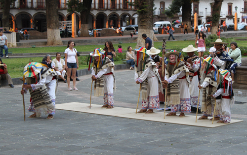 The dance makes fun of the Spanish colonists who came to the region.