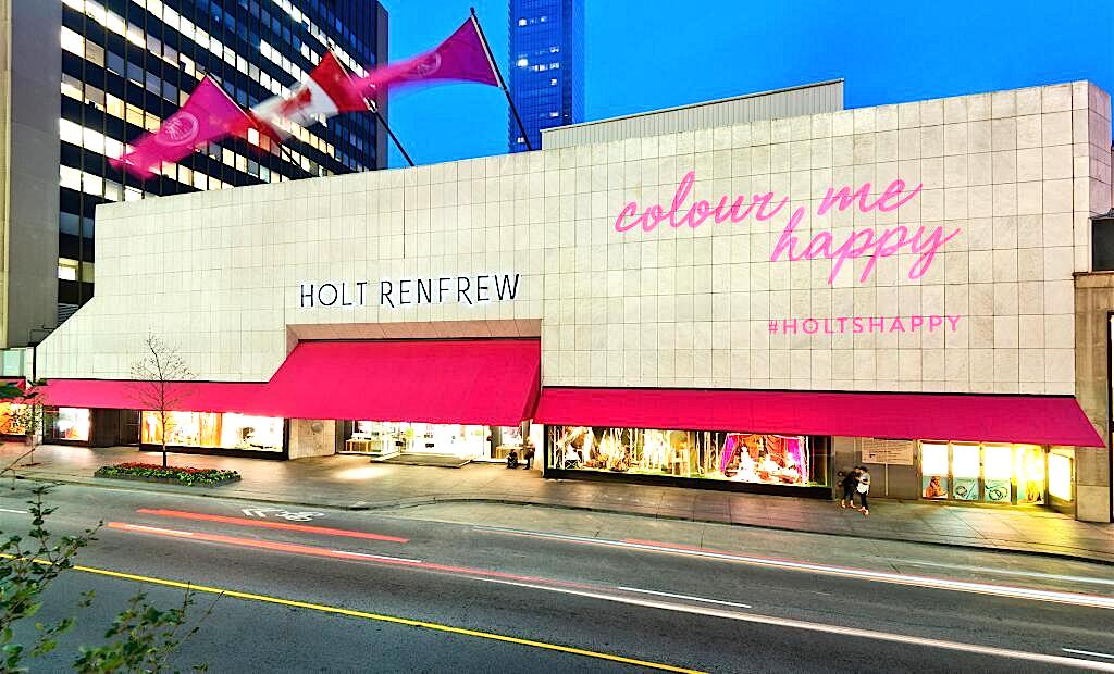 Holt Renfrew recently installed magenta coloured awnings to its flagship store at 50 Bloor St. W. in Toronto. Photo: Holt Renfrew, via Twitter.