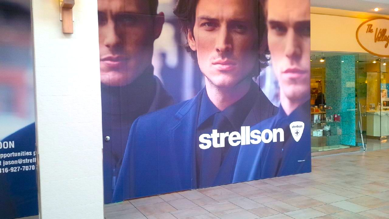 Hoarding over Bayview Village's new Strellson store, currently under construction. Photo: ACT7, Urban Toronto.