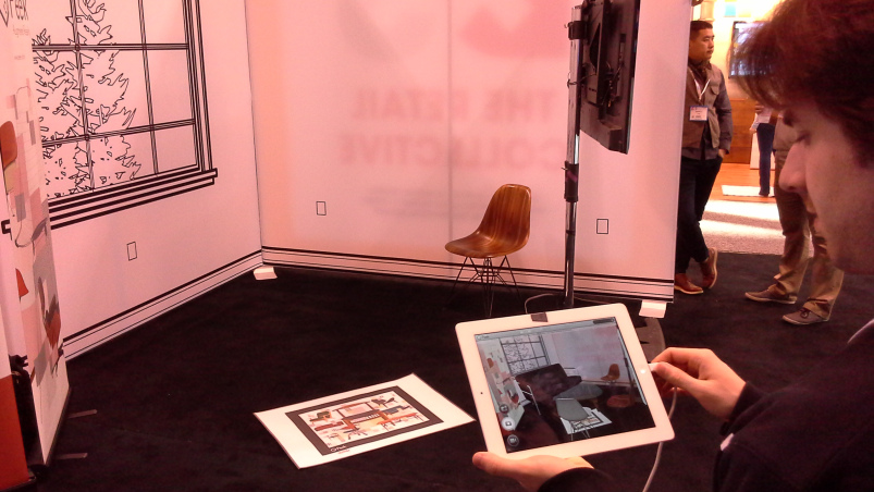 """Demonstration of Peek app: A """"marker"""" is placed on the floor, which then brings a realistic representation of the products to life on screen"""