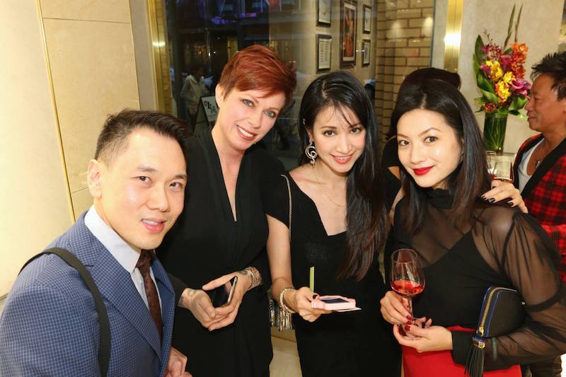 Lawyer Ritchie Po (far left) and  THECloset YVR  owner Helen Siwak (red hair) with Lao Feng Xiang reps at the Vancouver store's grand opening. Photo: Nick Darcy.