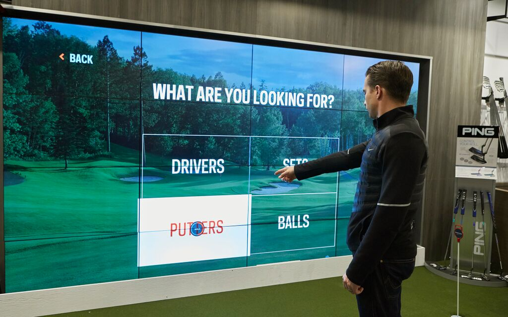 An interactive screen designed to help customers with a golf product just by pointing on boxes on the screen.