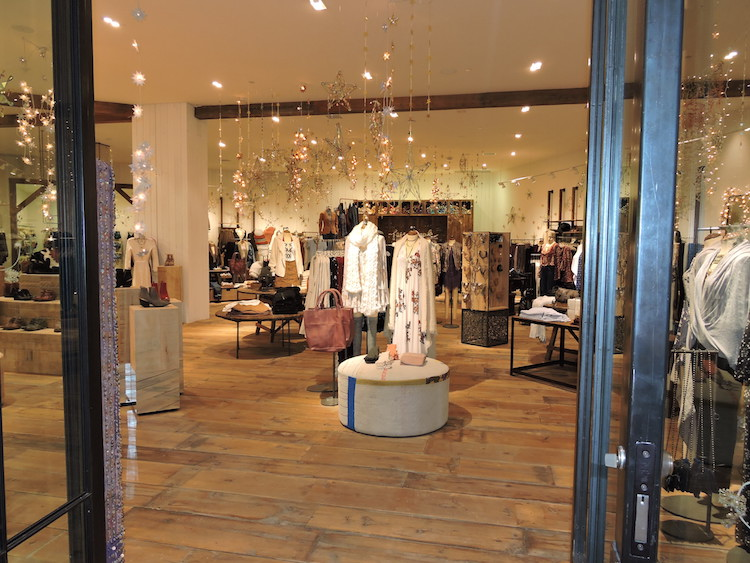 Reclaimed wide plank wood floors encompass the main sales floor in the new CF Sherway Gardens store.