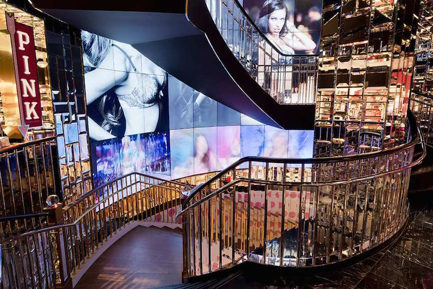 Marble and glass stairway and video screens
