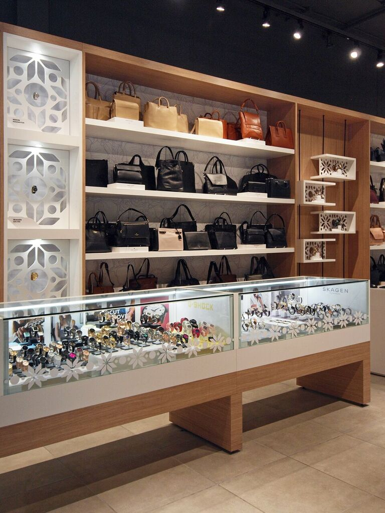 Wall and glass counter displays for leather goods and watches. Photo:  Peregrine.Build