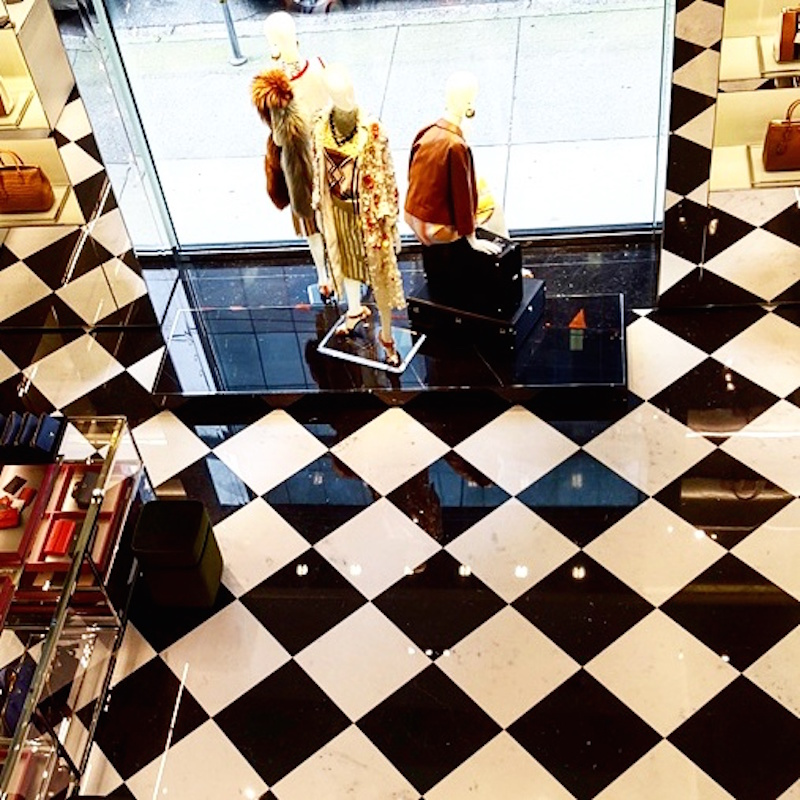 Glossy marble floors in women's accessories on the ground floor. Photo: Helen Siwak of @Eco.Lux.Luv