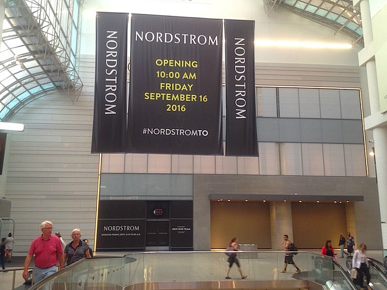 May 26, 2016. Hoarding was recently removed at CF Toronto Eaton Centre, revealing two store entrances and the facade for 'Ebar', covered in black. Photo: Craig Patterson for Retail Insider.