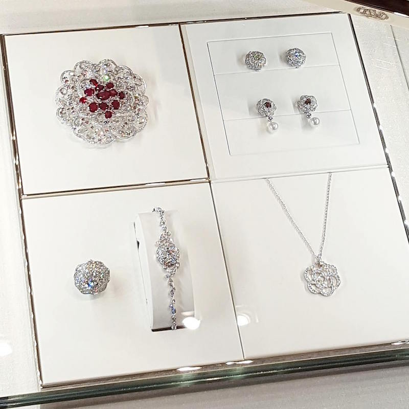Top left: $3 million '  Camillia  ' diamond broach with 'pigeon blood' red rubies. Photo: Helen Siwak of @Eco.Lux.Luv