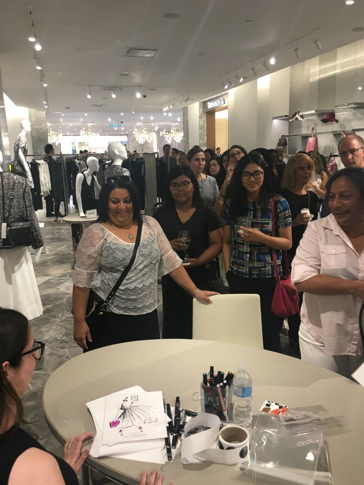 Artist sketches customers in the store's accessories hall. Photo: Chantal Mizerski, Retail Council of Canada.