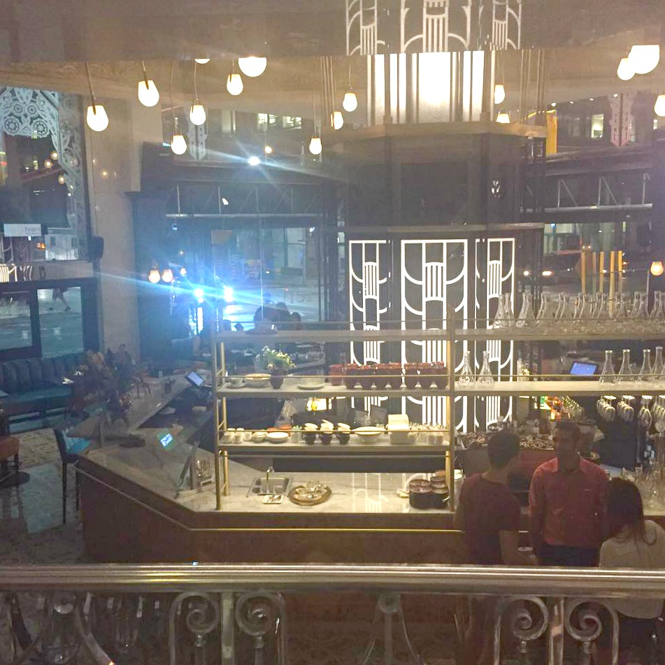 Looking down to the street level bar from a railing 1/2 floor above (same level as Saks' ground floor accessories/beauty)Photo:Chef Julie Marteleira