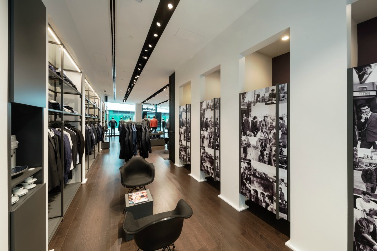 Dressing room area at the back of the store includes seating as well as coffee.