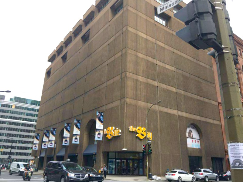 Extreme makeover: Current Boulevard de Maisonneuve facade to see overhaul. The stucco exterior will be removed and replaced with a dramatic Saks storefront. Photo:  Maxime Frechette .