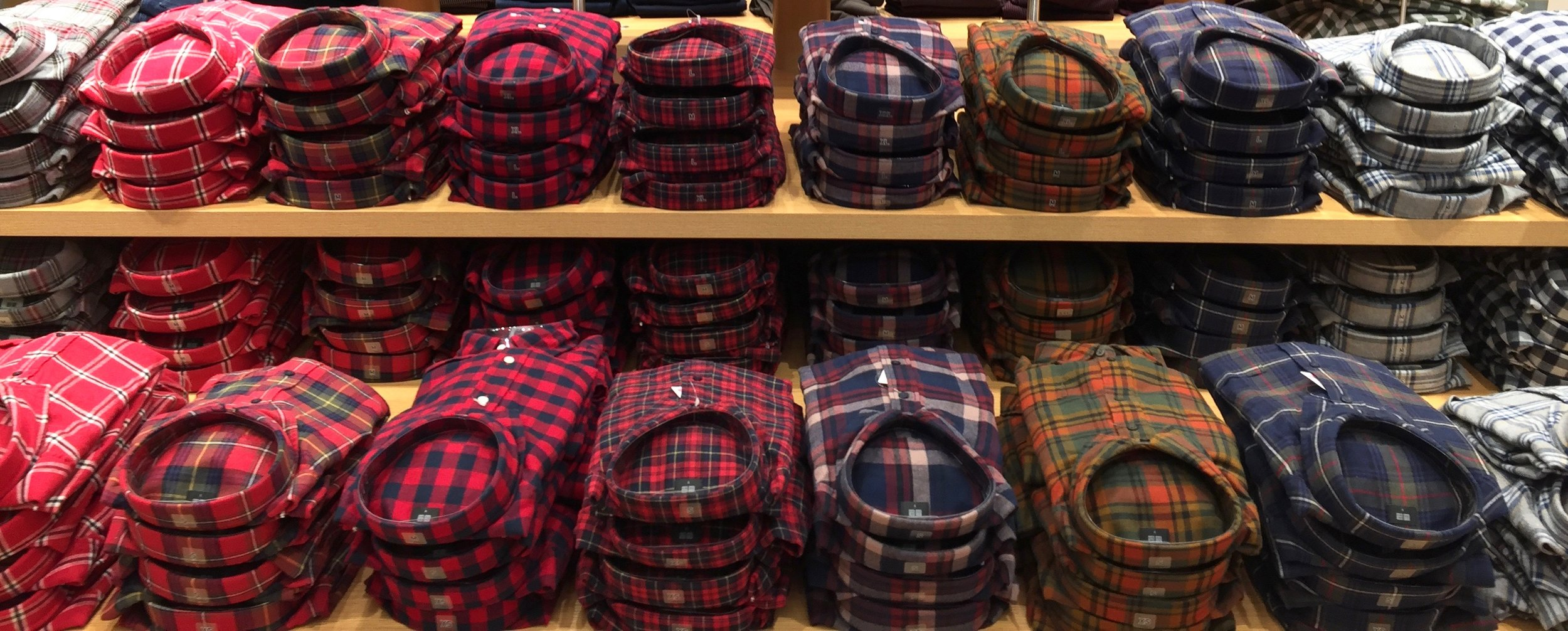 Flannel shirts are stacked by colour on the front display table.  Photo: Devon Johnson