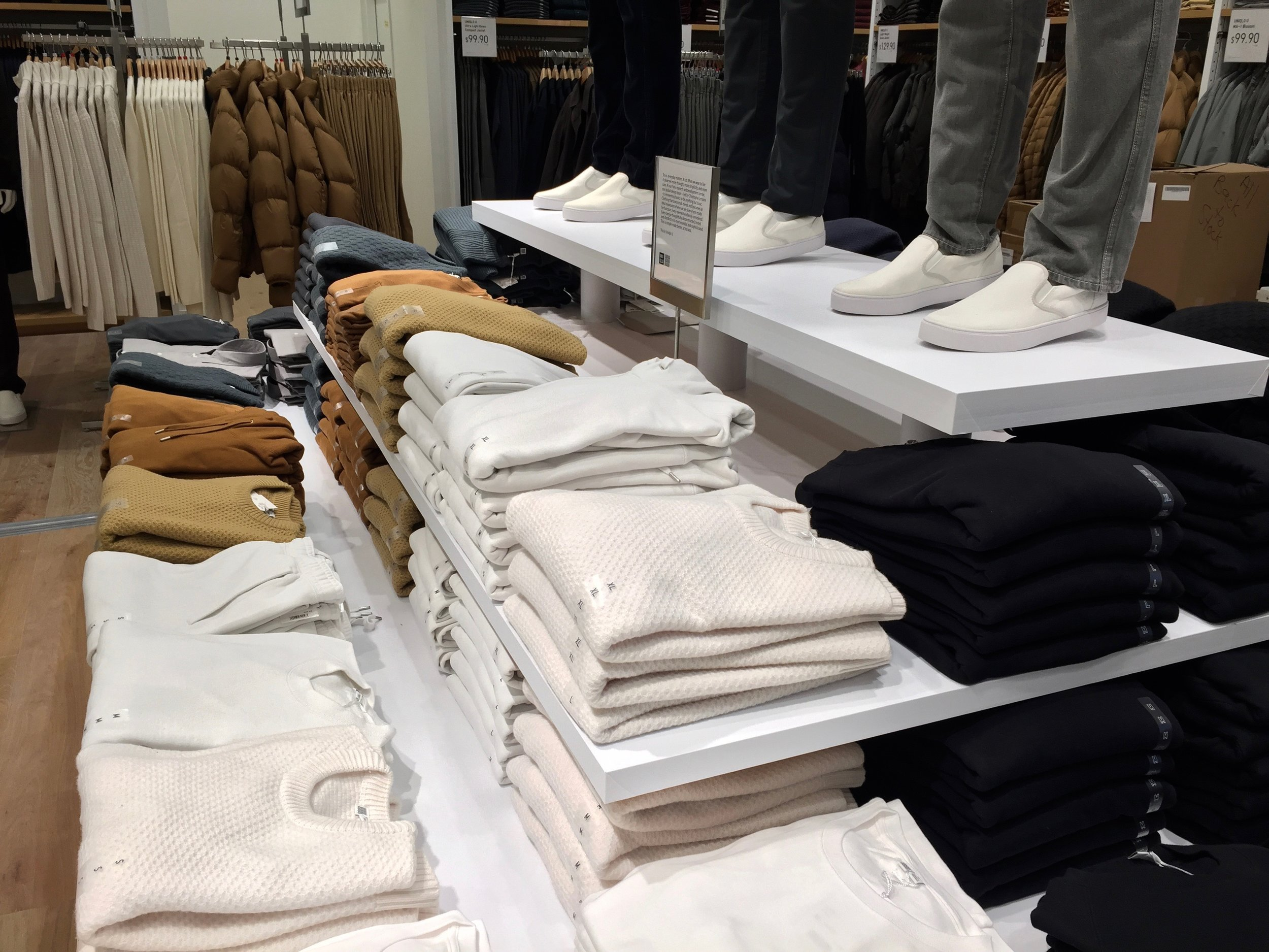 Men's sweaters from the 'Uniqlo U' clothing line sit on the second floor display table. Photo: Devon Johnson