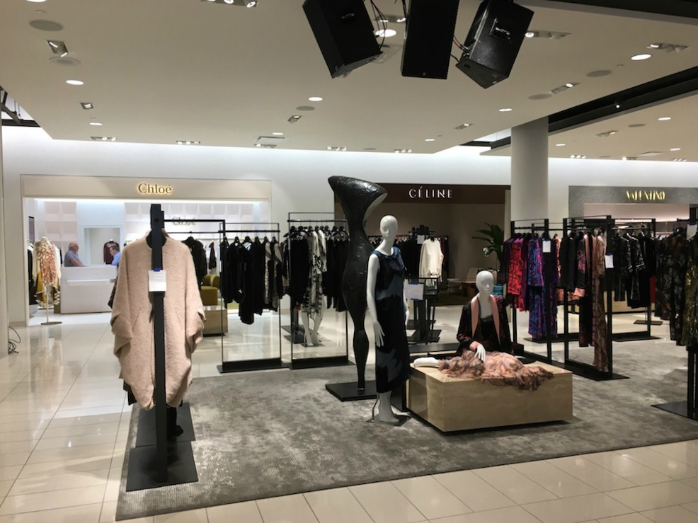 (Women's 'Collectors' designer floor, featuring fashions priced into the thousands)