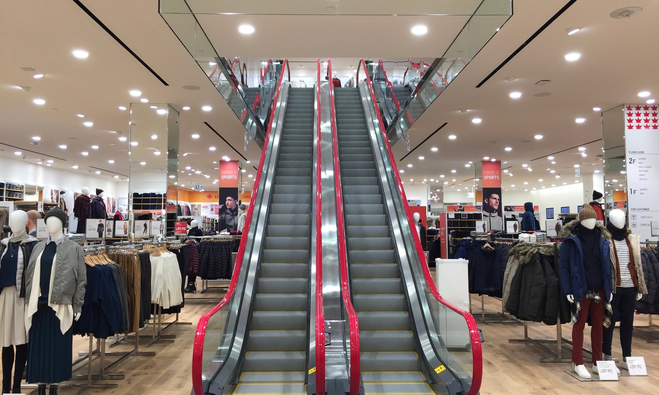 Customers are greeted by two large escalators that lead shoppers to more men's and women's collections.