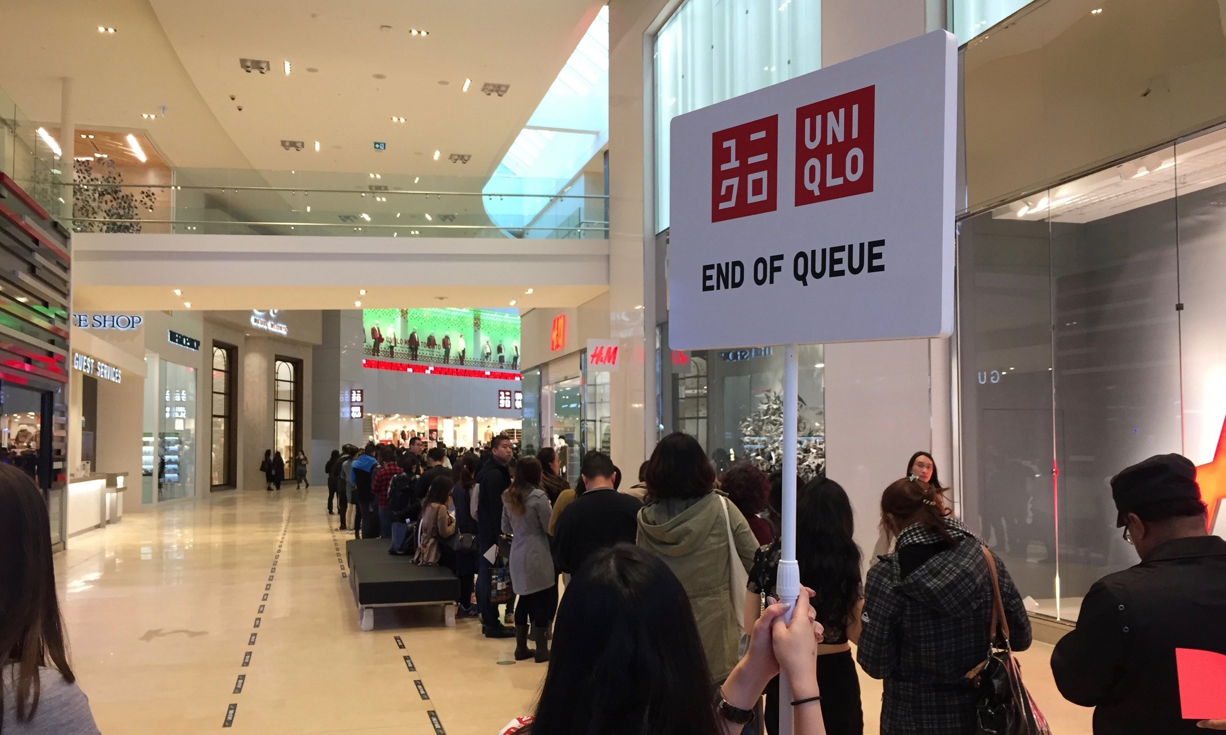 (Uniqlo's opening day lineup extended past H&M)