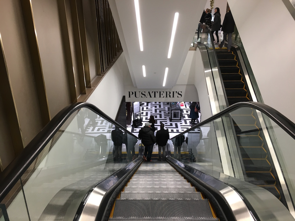 (Standing on Saks Fifth Avenue's ground floor, looking down the escalator towards the concourse-level Saks Food Hall by Pusateri's)