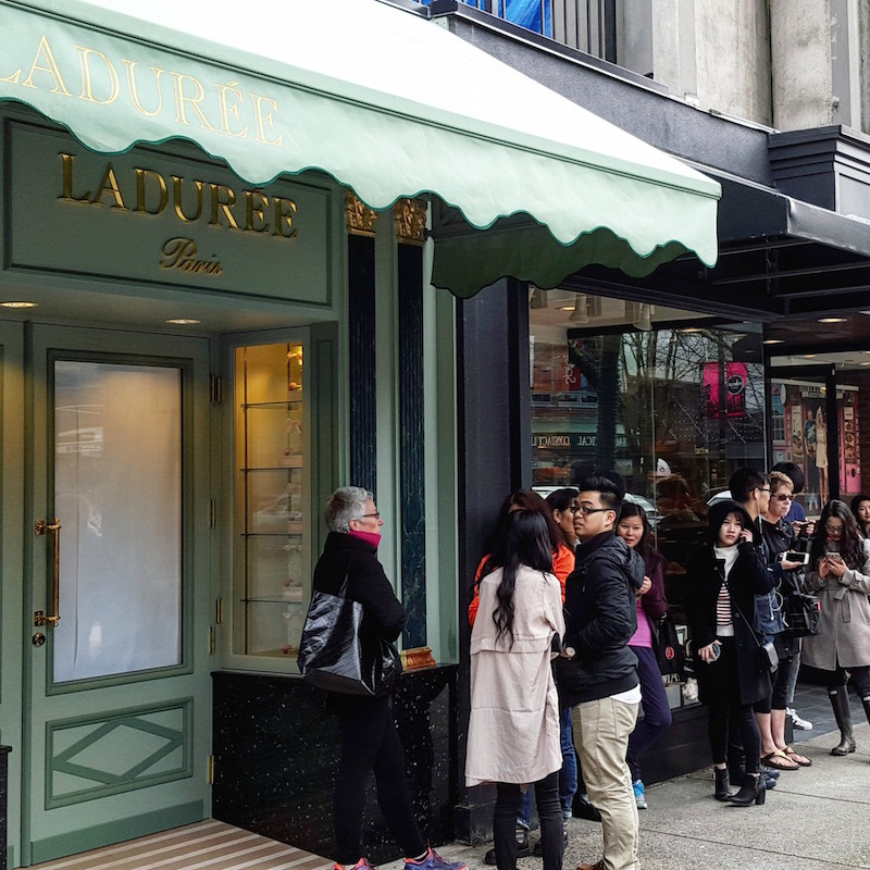 (lineup for the opening of ladurée on robson street in vancouver, march 2016. Photo: Helen Siwak)