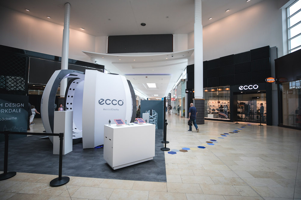 (promotional installation in front of the new yorkdale store. Until june 30, shoppers can have miniature versions of themselves created, via Toronto-based  Selftraits )