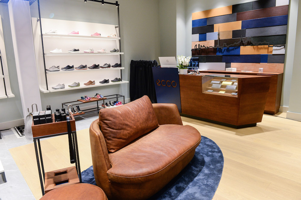 (The toronto skyline on a leather installation behind the store's cash desk. seating is elevated and comfortable)