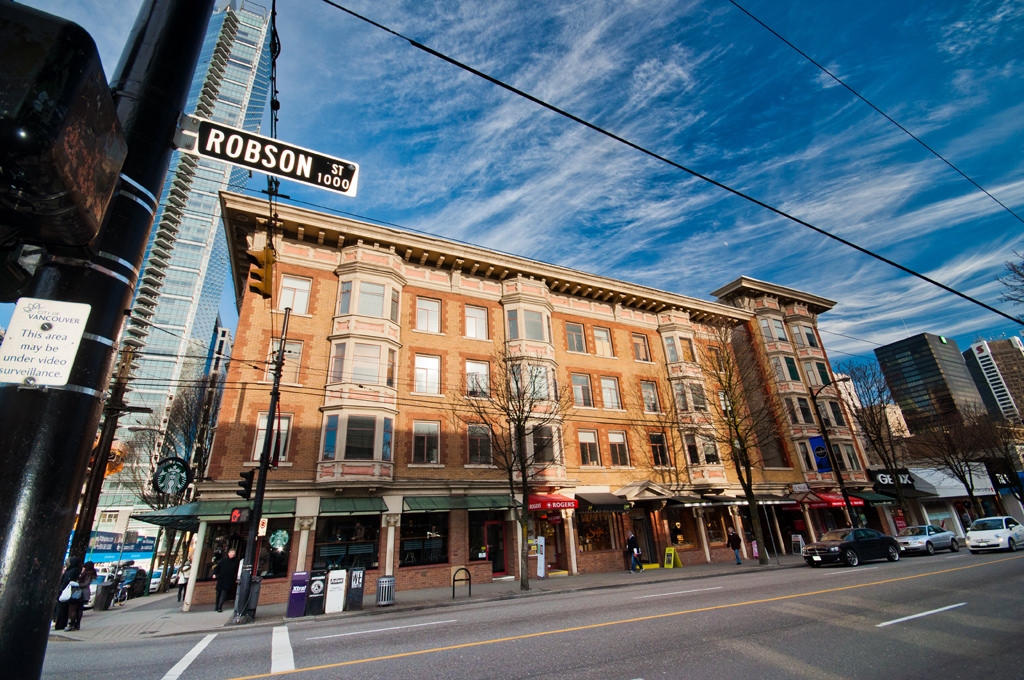 (Manhattan block at the northeast corner of robson street and thurlow street. Short buildings to the right to be demolished for a large, new retailer. Photo: Tourism Vancouver)