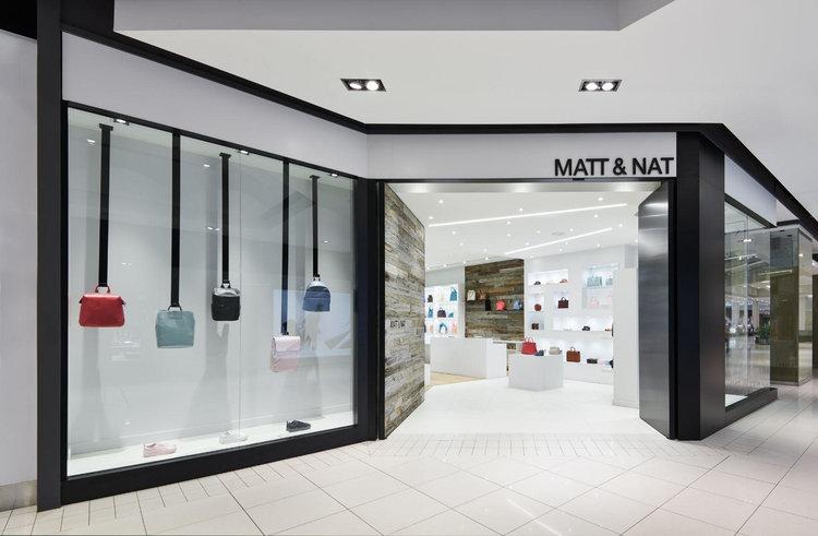 (an angled, inviting entrance attracts attention: Matt & Nat at Ottawa's CF RIDEAU CENTRE. PHOTO:    PHOTOLUX STUDIO   )