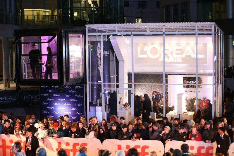 (Crowds gather at Loki Box Design's L'oreal installation. Note the VIP 'box' in purple. Photo: Loki Box Design)
