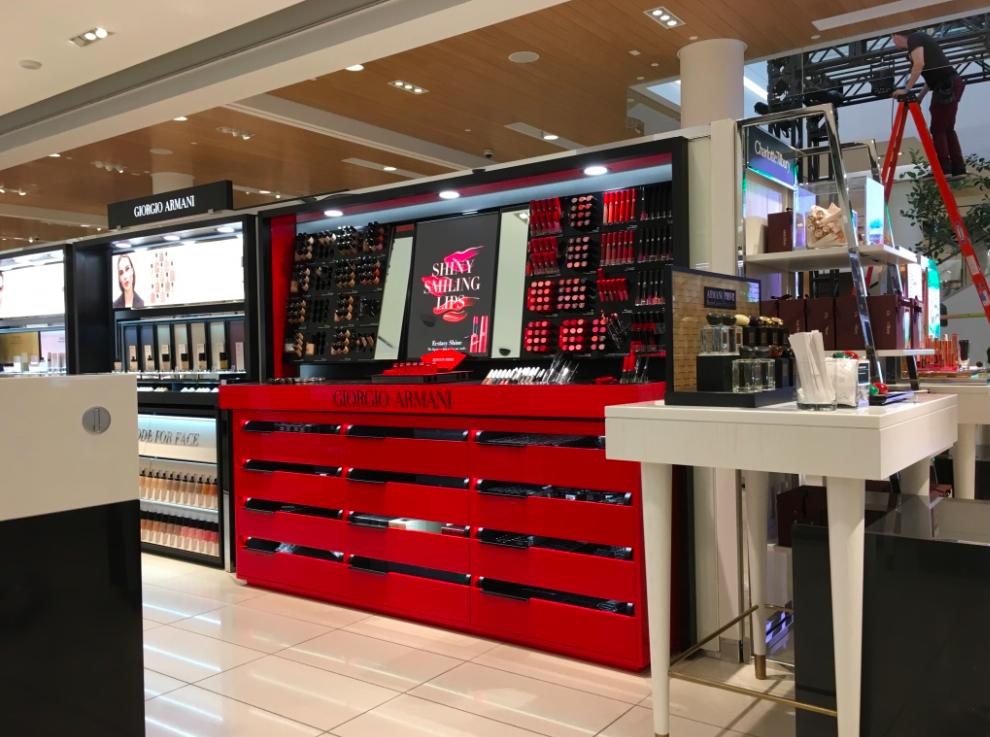 (Armani cosmetics pops in red)