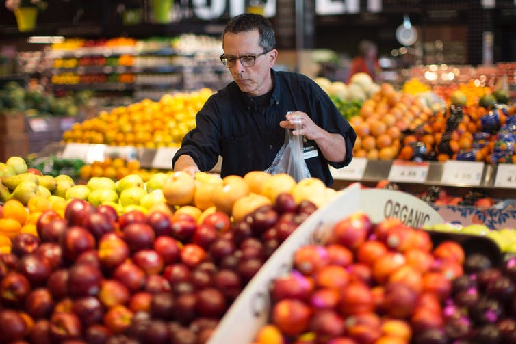 (A worker for Loblaw's Click and Collect service gathers a customer's order at one of the grocery chain's outlets in Toronto in June 2016.THE CANADIAN PRESS/Chris Young)