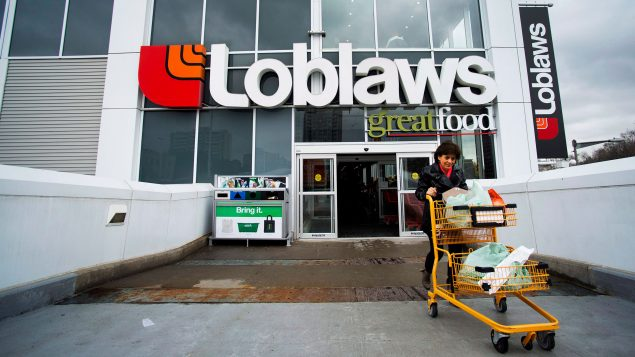 A women carts out her groceries from a Loblaws in Toronto on May 1, 2014. THE CANADIAN PRESS/Nathan Denette