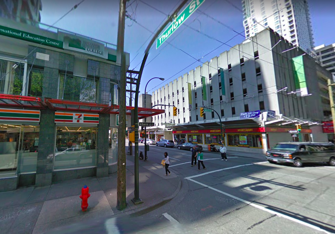 (Google Street view shot from April of 2009 -- Prada replaced 7-Eleven to the left and to the right, the parking garage was demolished for the 745 Thurlow Street office tower which houses Brunello Cucinelli and Versace at its base)
