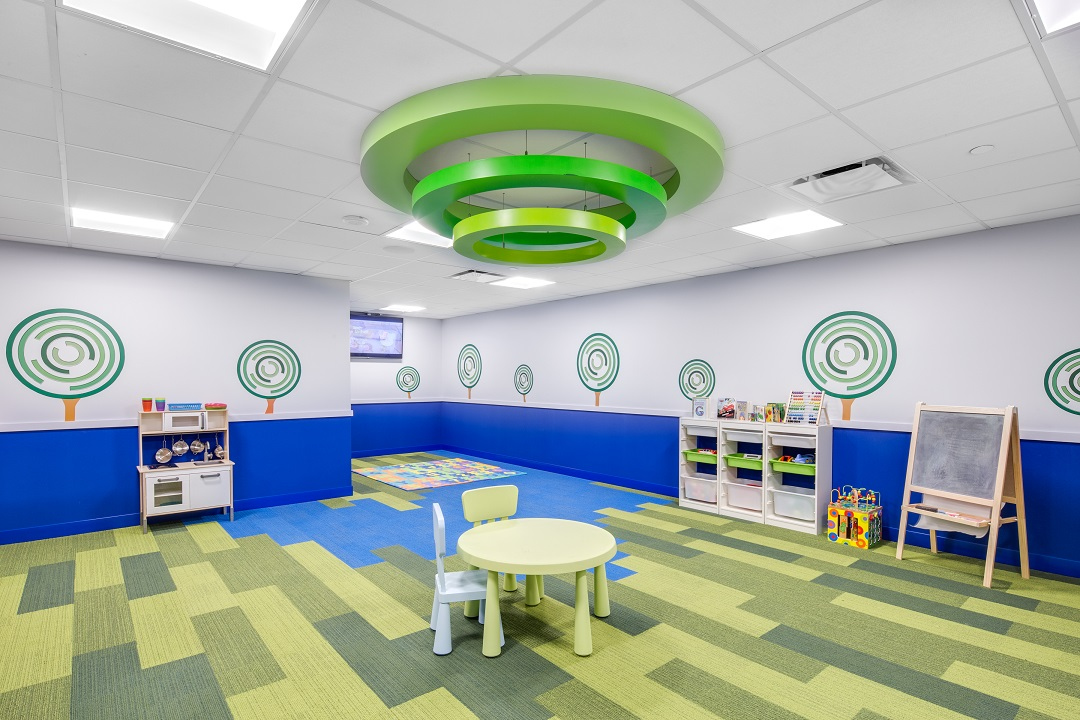 Ceiling ring feature by  Peregrine Retail Design Manufacturing