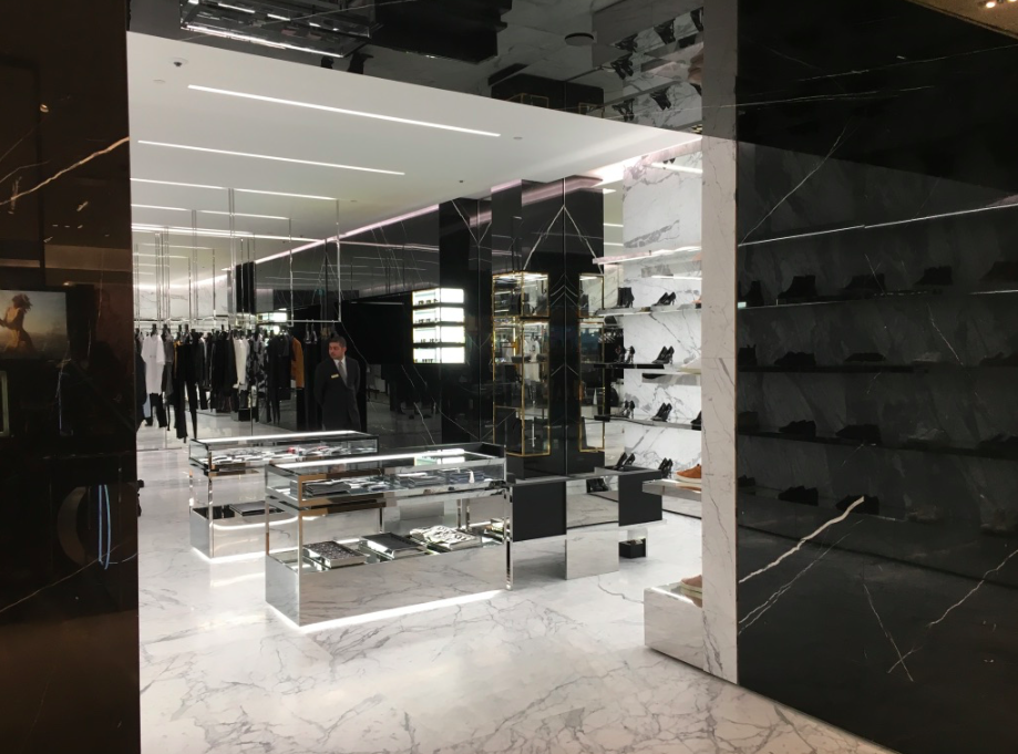 [Looking into the store from Holt's cosmetics department. Men's ready-to-wear is at the back of the photo]