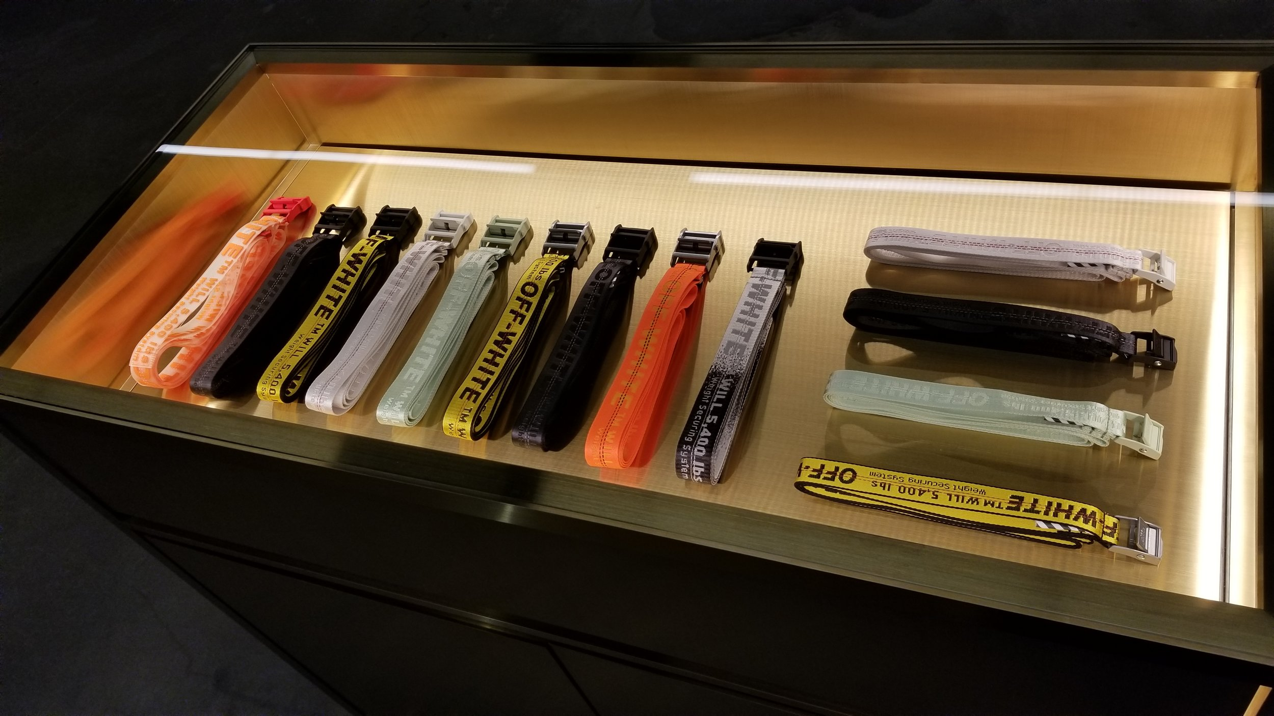 [Display with belts, priced at $275 each. Photo: Helen Siwak]