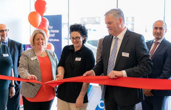 Members of the Wellwise team officially open the store in Etobicoke during the ribbon-cutting ceremony on Saturday, April 7.