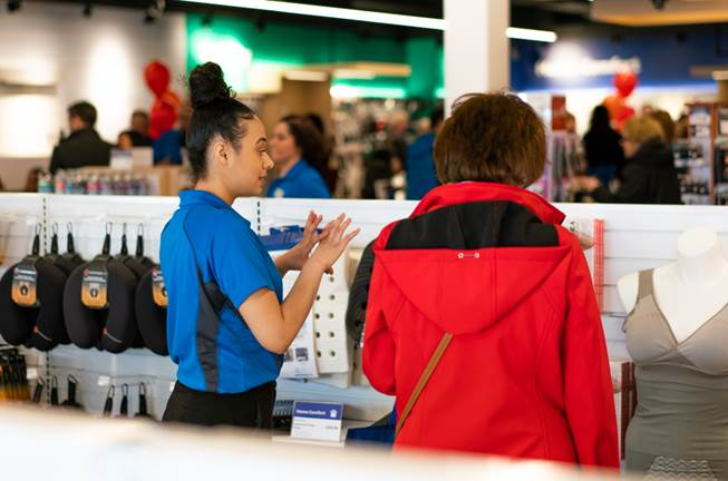 A member of the Wellwise team offers advice at the grand opening of the Wellwise store in Etobicoke on Saturday, April 7.