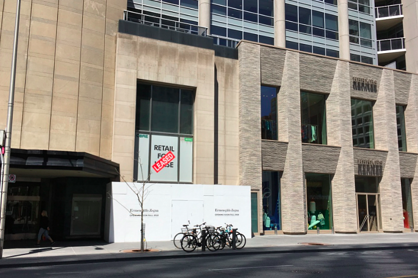 Construction signage is now up on the one-level space that will feature a two-level branded Zegna facade. Photo: Craig Patterson/May 9, 2018