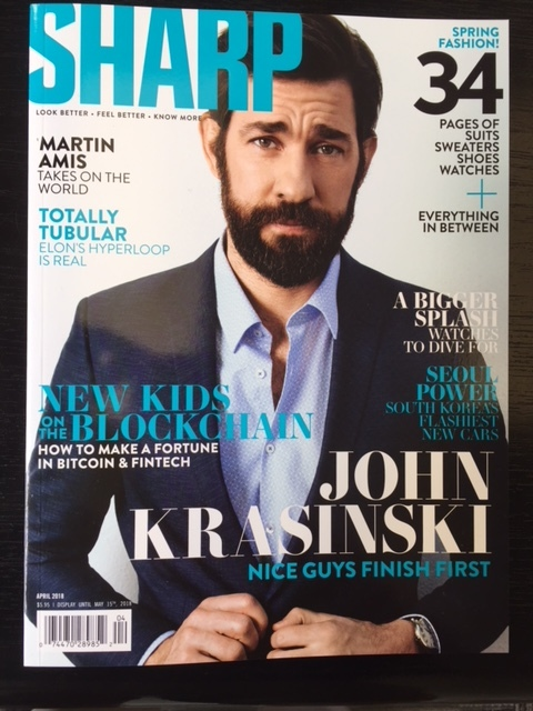 John Krasinski wears a Strellson ink-blue 'Allen-Mercer' suit on the front cover of Sharp Magazine's April 2018 edition.