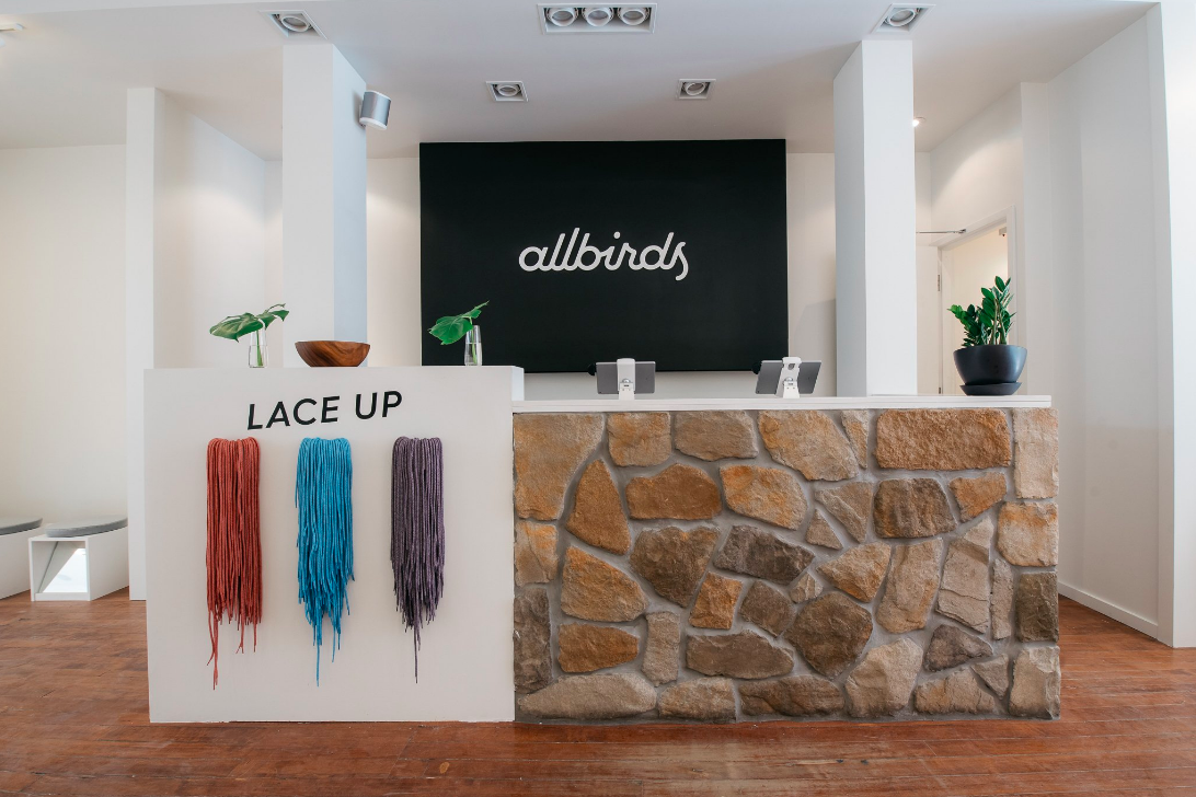 Cash Desk with shoe laces displayed. Photo: Allbirds
