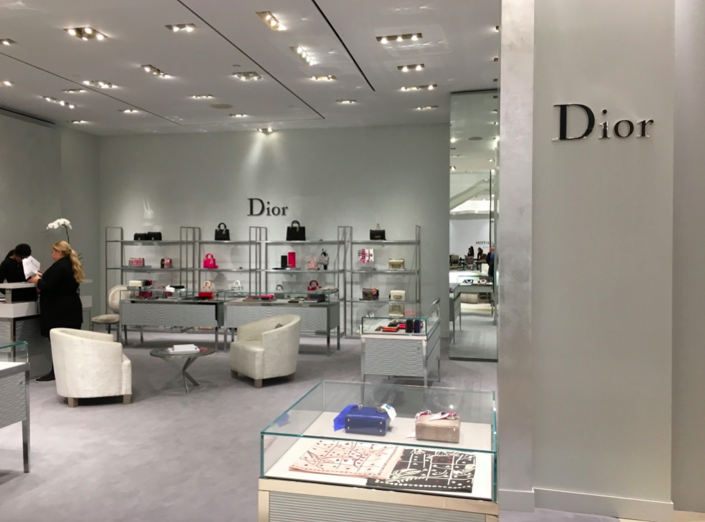 Temporary Dior accessory concession on the ground floor, next to a recently opened Saint Laurent boutique