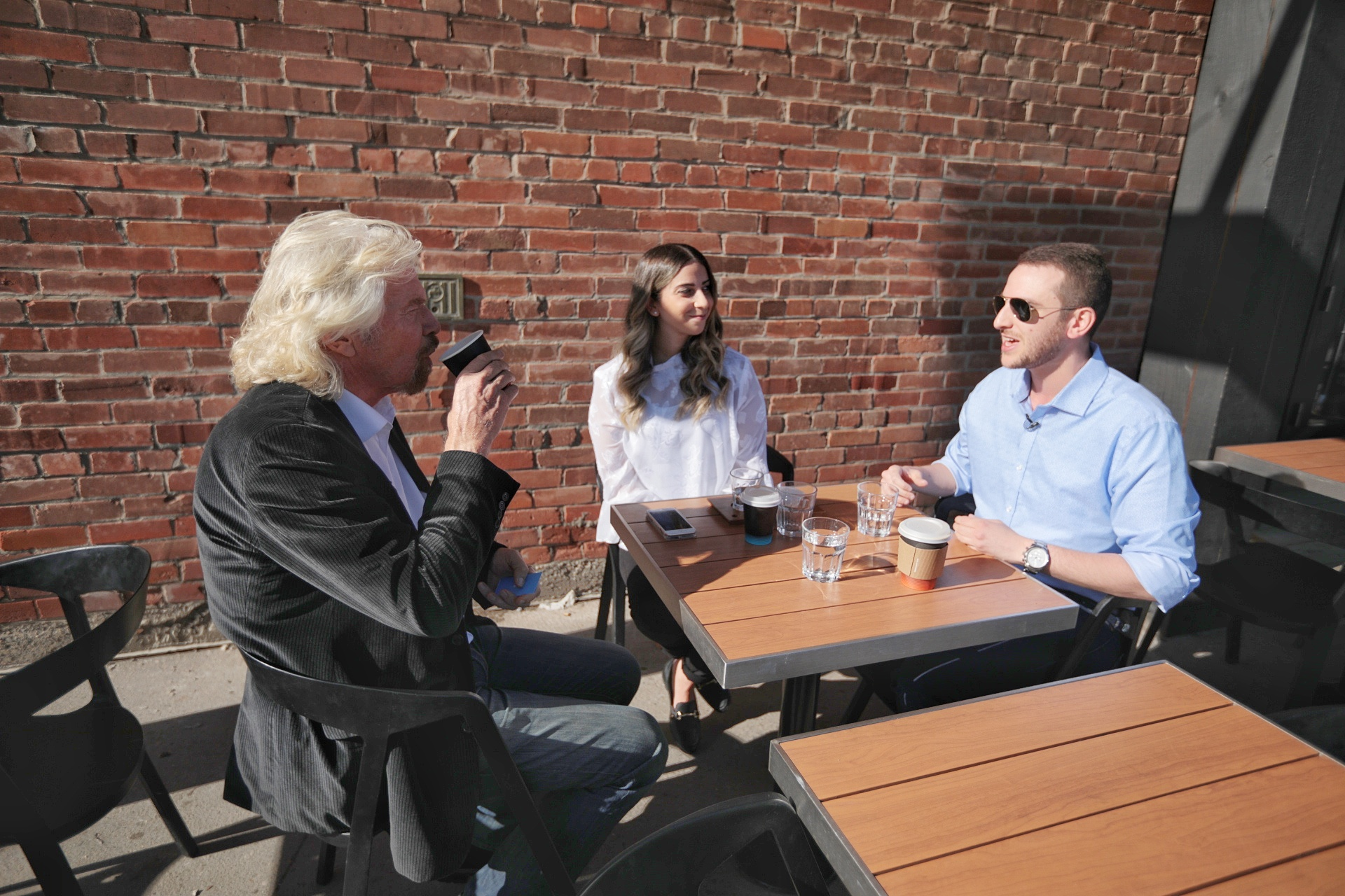 Richard branson sits with Swob's Stephanie and Alexander in Calgary.
