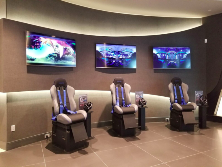 (VIRTUAL REALITY SEATING AREA at Samsung store in CF Toronto Eaton Centre. CUSTOMERS WERE ENJOYING THE EXPERIENCE WHEN WE VISITED THE STORE. PHOTO: SAMSUNG)