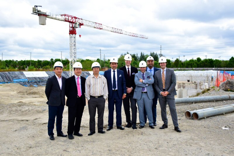 Executives from King Square Ltd, OMJ Capital and Fortress Real Developments at the King Square site where construction was underway.