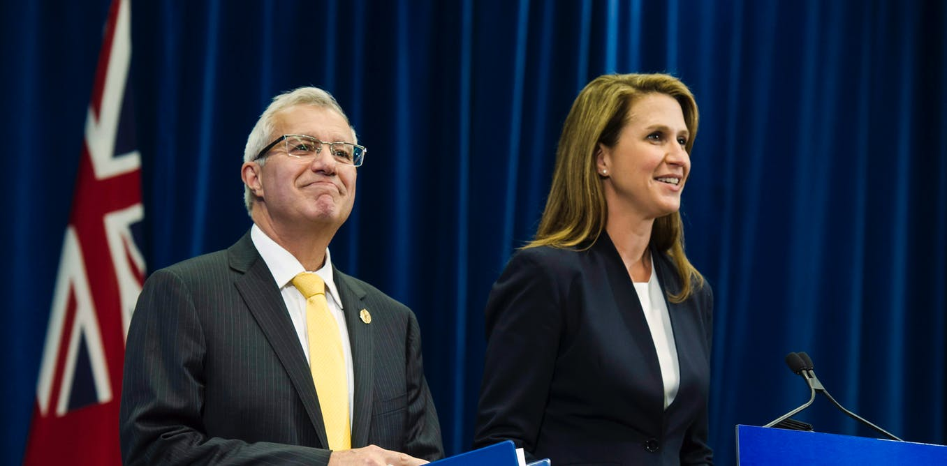 Vic Fedeli, Ontario's finance minister, and Attorney General Caroline Mulroney talk to the media after announcing Ontario's cannabis retail model on Aug. 13.THE CANADIAN PRESS/Christopher Katsarov