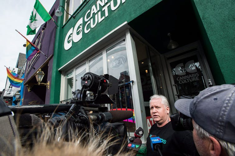 Stores in Ontario currently selling cannabis illegally will need to shut down before Oct. 17 and they apply for a legal retail licence. In this photo from March 2017, store manager Mark Harrison speaks to media outside a Cannabis Culture store following a police raid in Toronto on Thursday, March 9, 2017. THE CANADIAN PRESS/Aaron Vincent Elkaim