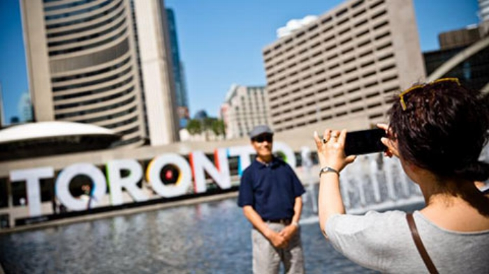 taking-a-photo-in-front-of-toronto-sign.jpg